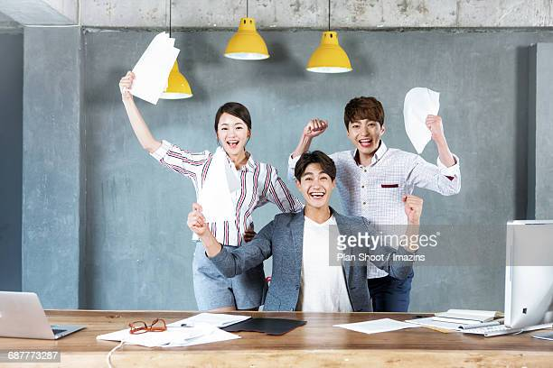 Three Office workers Cheering