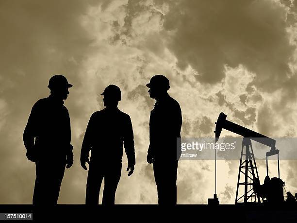 Three Oil Workers and Pumpjack with Moody Sky