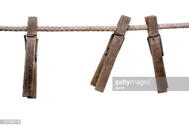 three old clothes pins