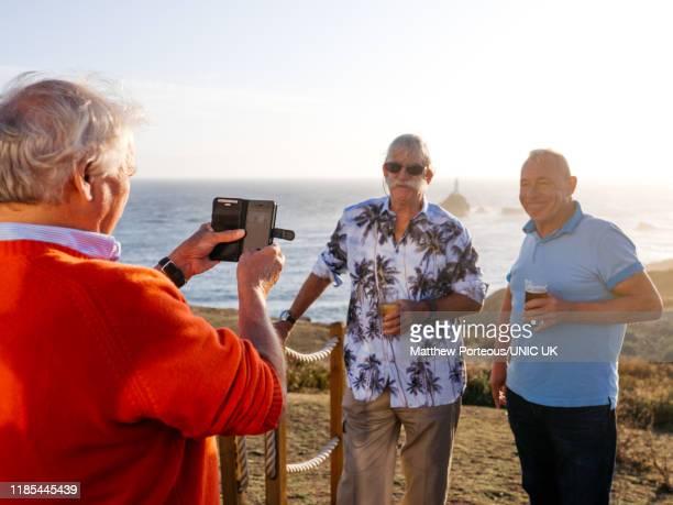 three old men take a photo