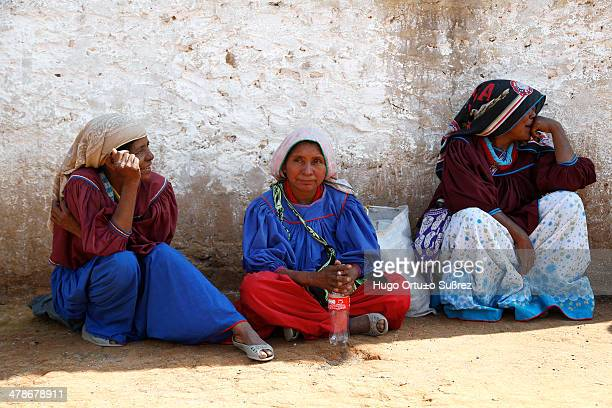 CONTENT] MEZQUITIC JALISCO MEXICO JUNE 11 Three old Wixarica women sit on the ground in the city of Mezquitic considered one of the largest...