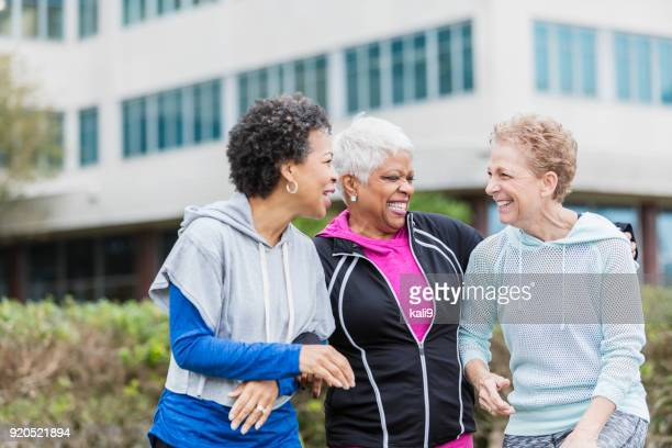 Three older multi-ethnic women hanging out together