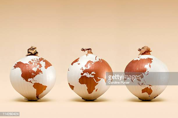 Three onions with map of the world on them