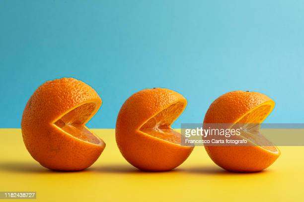 three oranges lined up - voice stock pictures, royalty-free photos & images
