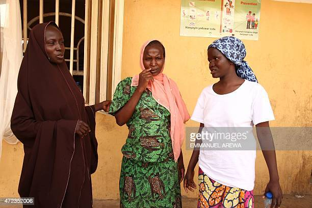 Three out of the eight pregnant women rescued by Nigerian soldiers from Islamist militants Boko Haram at Sambisa Forest stand on May 6 2015 at...