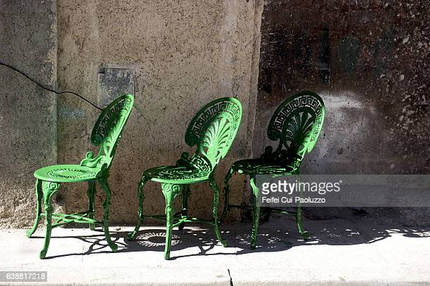 Three outdoor chairs at street of Vieja Havana in Cuba