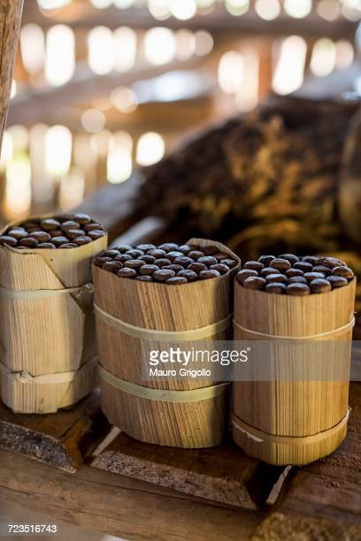 three packages of hand made cuban cigars on workbench, vinales, cuba - pinar del rio stock photos and pictures