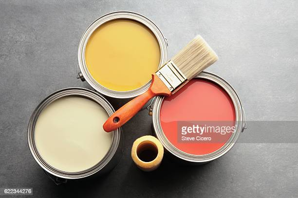 three paint cans with brush and roller - image foto e immagini stock