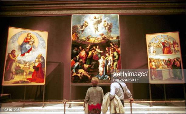 Three paintings by Raphael from left to right the 'Foligno Madonna' the 'Transfiguration' the 'Virgin's crowning' in Rome Italy on March 28th 2000