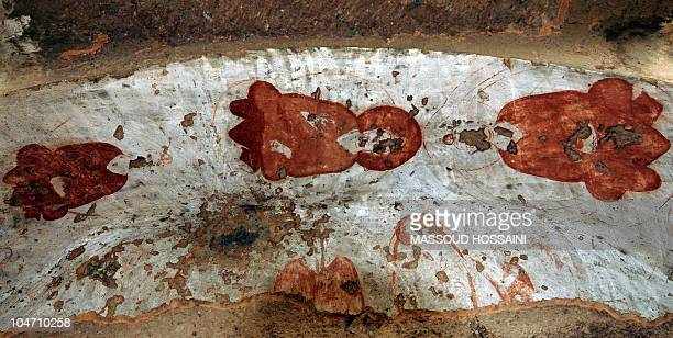 Three paintings of Buddha which were damaged by the Taliban are seen at the top of a cave's entrance in Bamiyan on October 15 2008 at the...