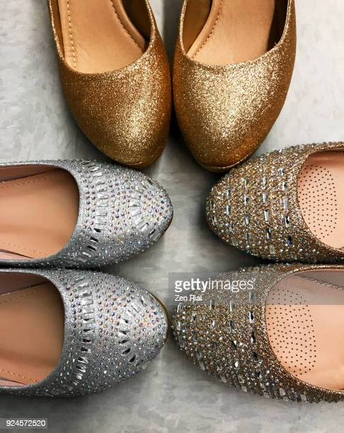 Three pairs of glittery shoes in gold and silver