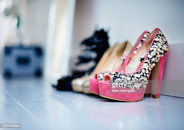 three pairs of heels side by side against wall. - high heels stock pictures, royalty-free photos & images