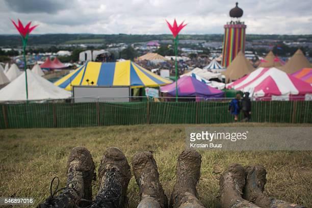 Three pairs of muddy wellies at Glastonbury Festival 25th July 2016 Somerset United Kingdom The Glastonbury Festival runs over 3 days and has 3000...