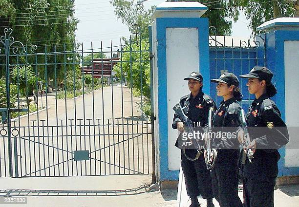 Three Pakistani female commandos stand guard at the main entrance of The Central Prison in Multan 26 July 2003 Three judges were killed in a rescue...