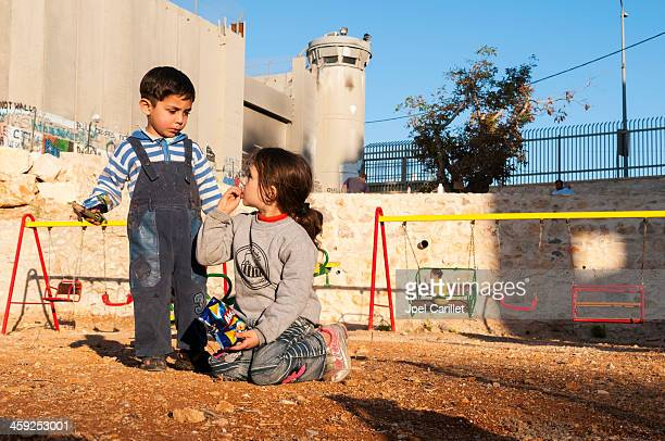 palestinian children and israeli separation barrier - palestinian stock pictures, royalty-free photos & images