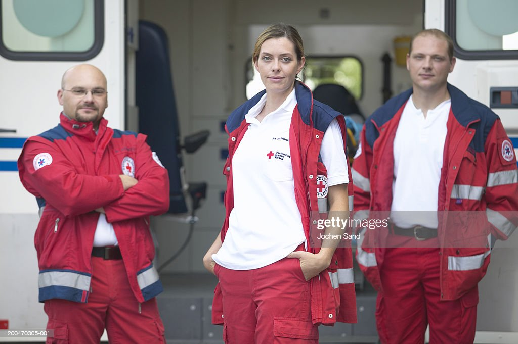 """Three paramedics standing beside ambulance, portrait"" : ストックフォト"