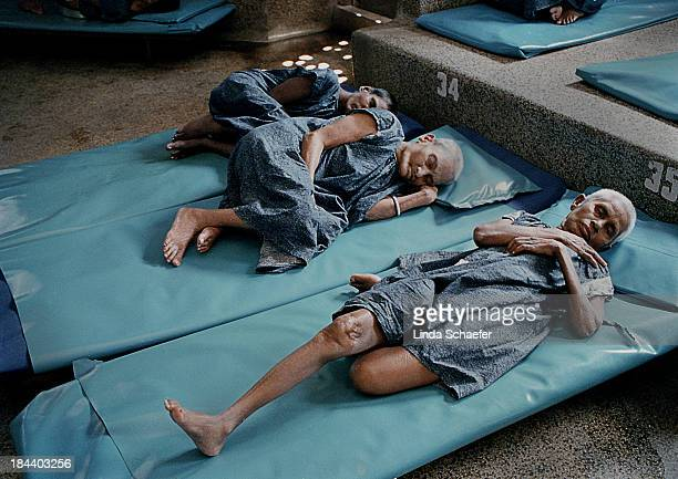 CONTENT] Three patients lay on the tiny beds provided by the Missionaries of Charity in Kolkata India The home for the dying was the first facility...