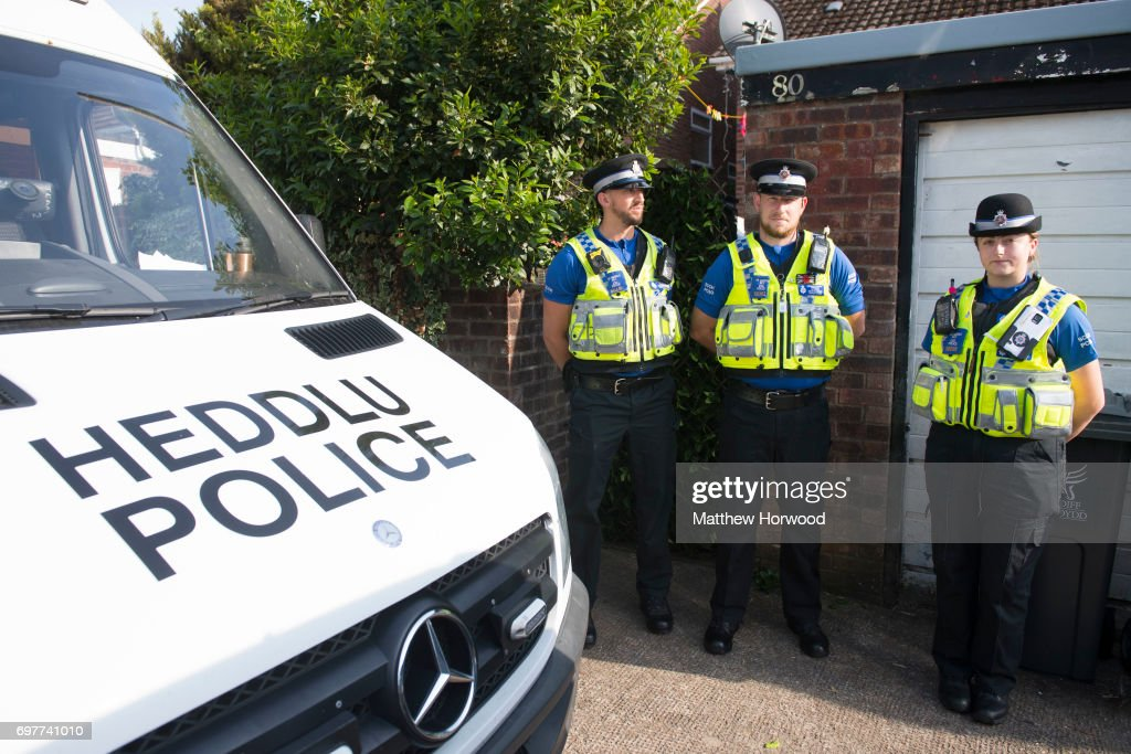Three PCSOs stand outside a property during a search of a house on Glyn Rhosyn, Pentwyn, which is believed to be the home of Darren Osborne, who has been named as the man responsible for the Finsbury Park Mosque attack, on June 19, 2017 in Pontyclun, Wales. A van ploughed into pedestrians near Finsbury Park Mosque on Severn Sisters Road, North London, at around 12.20 this morning. Police have reported that one man was killed and nine people were injured. 47-year-old Darren Osborne has been arrested. Prime Minister Theresa May has said police are treating it as a potential terrorist incident.