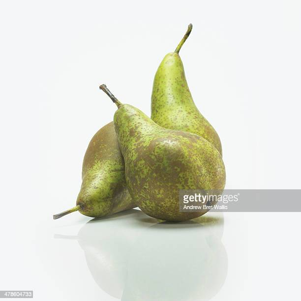 Three pears against a white background