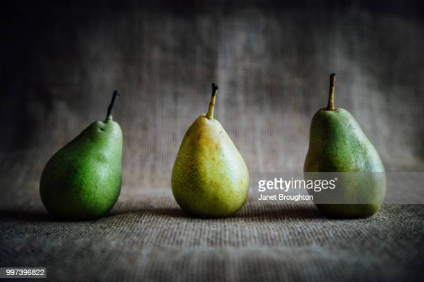 three pears in a row. - wabi sabi stock pictures, royalty-free photos & images