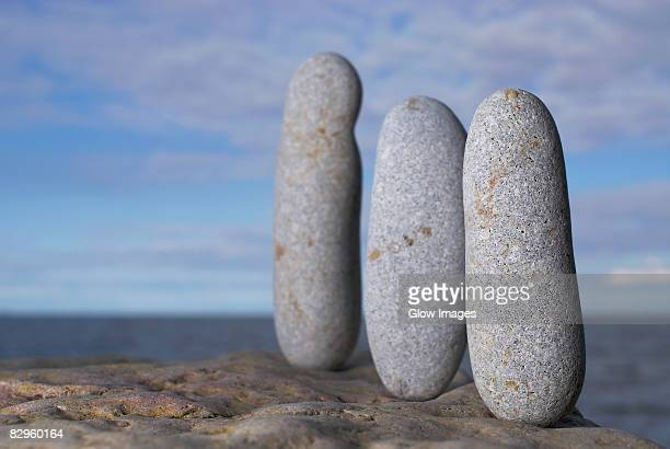 Three pebbles on a rock