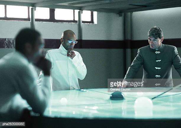 Three people around table