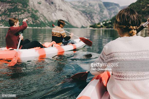 Three people canoeing