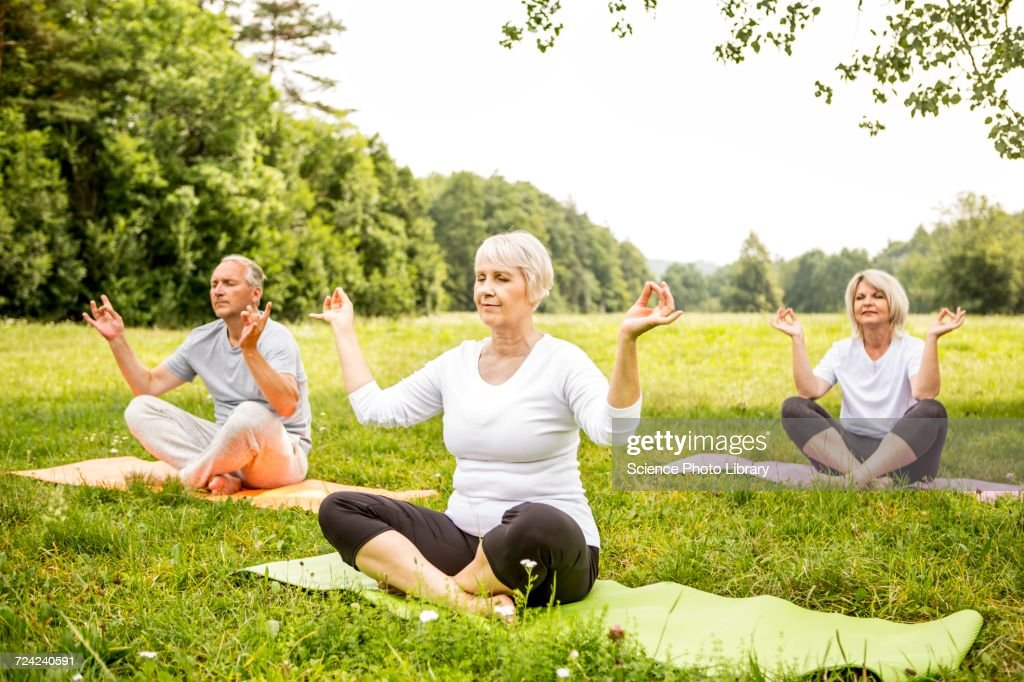 Three People Doing Yoga In Field High Res Stock Photo Getty Images