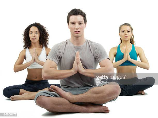 Three people doing yoga