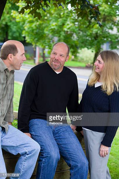 three people in conversation