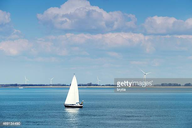 Three people in sailboat on the Eastern Scheldt, Netherlands