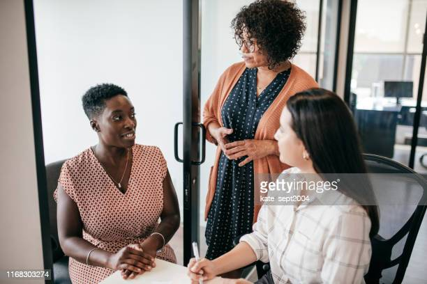 three people in the office - kate green stock pictures, royalty-free photos & images
