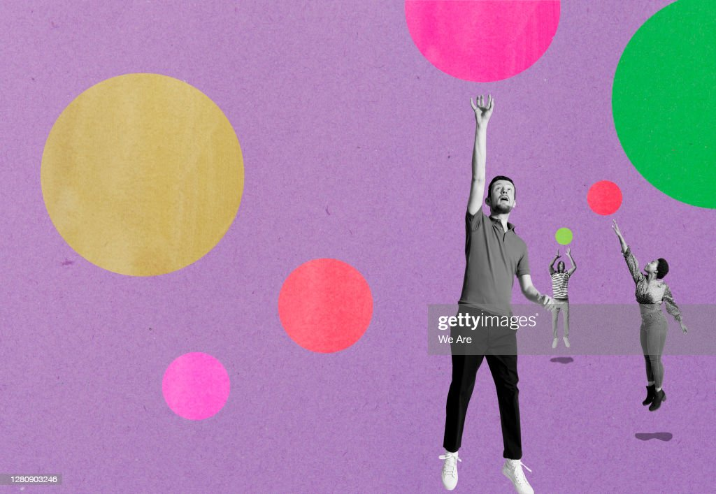 three people jumping for bubbles : Stock Photo