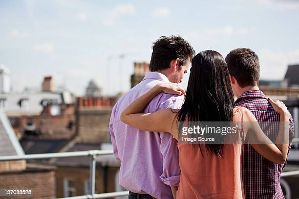 Three people looking at something together