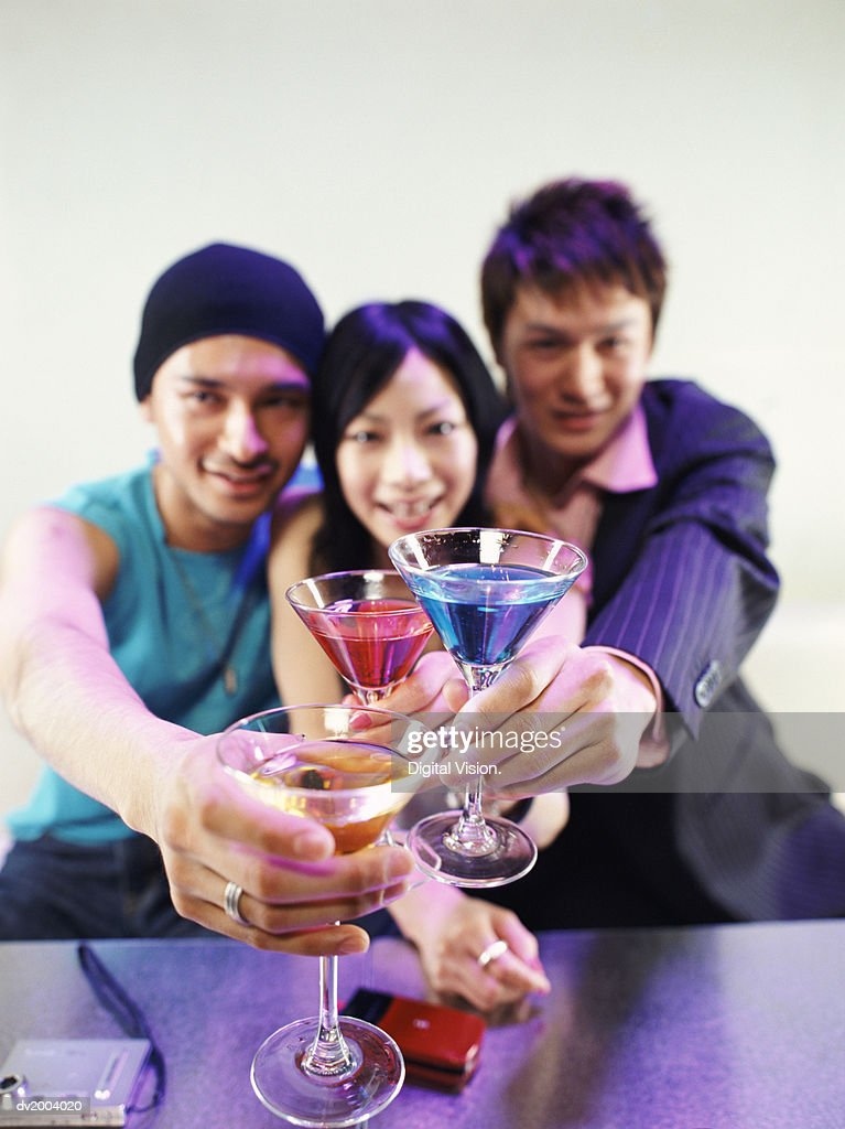 Three People Making a Toast With Cocktails : Stock Photo