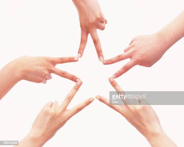 Three people making star with hands