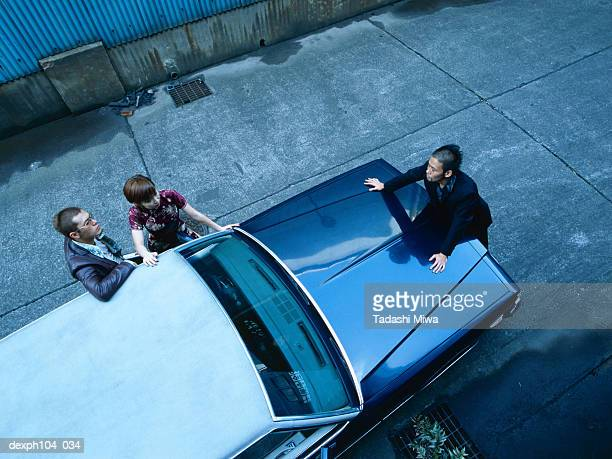 Three people negotiating, view from top