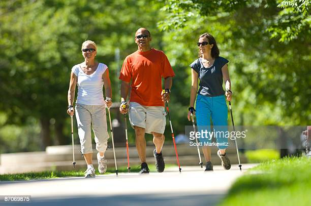 Three people nordic walking in Salt Lake City, Utah.