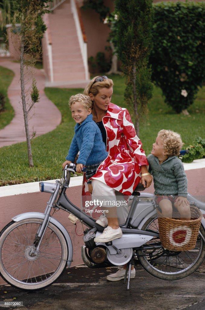 Three people on a bicycle in Bermuda, November 1969.