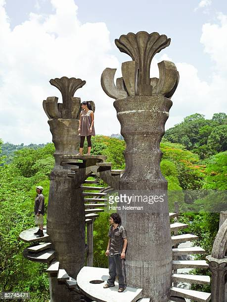 three people on a surreal architectural stru - las posas stock pictures, royalty-free photos & images