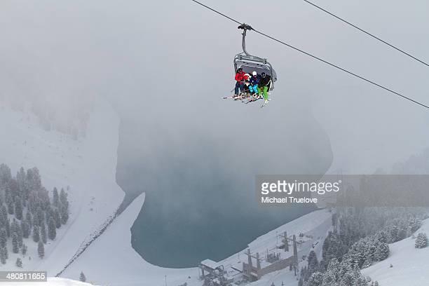 Three people on ski lift in Kuhtai, Austria