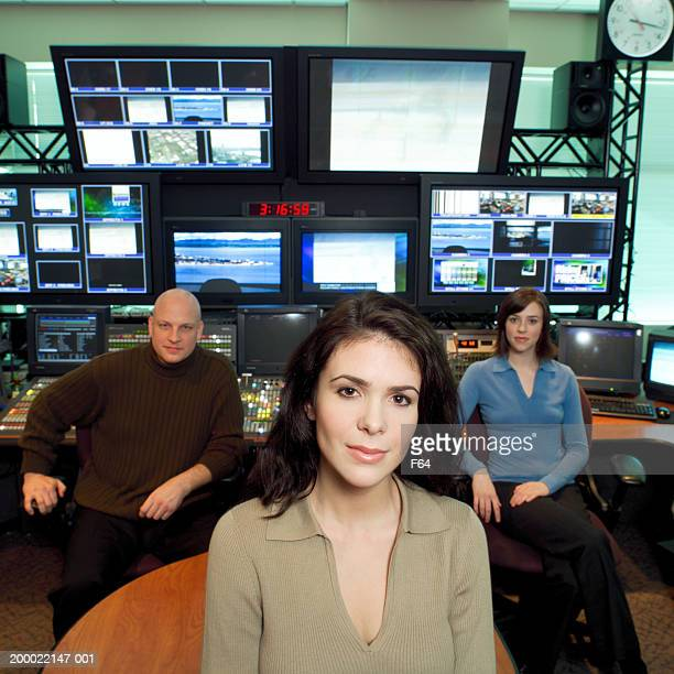 three people seated in television control room - producer stock pictures, royalty-free photos & images