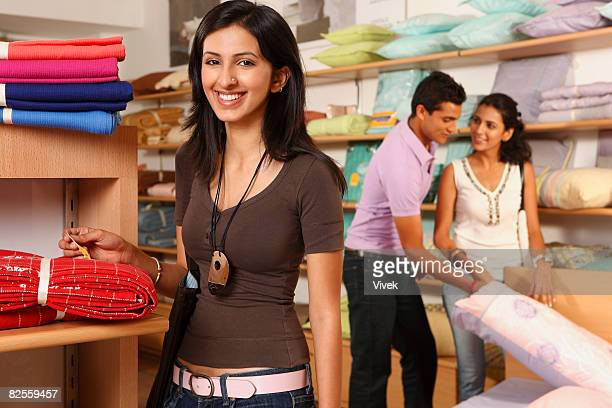 three people shopping in household store