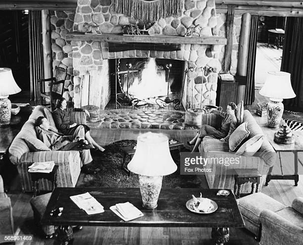 Three people sitting in the main lounge of Eaglecrest the lodge where Queen Elizabeth II and Prince Philip will stay during their visit on Vancouver...