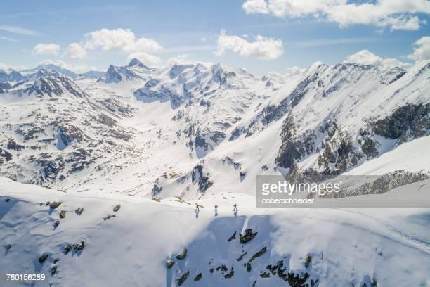 three people ski touring, sportgastein, gastein, salzburg, austria - kleine groep mensen stockfoto's en -beelden