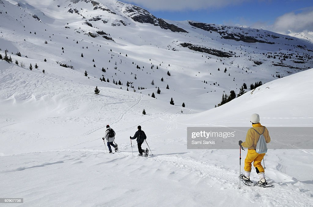 Three people snowshoeing, French Alps, France : Stock Photo