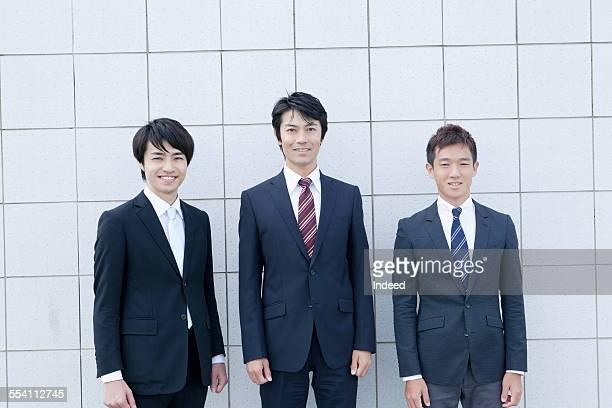 Three people standing