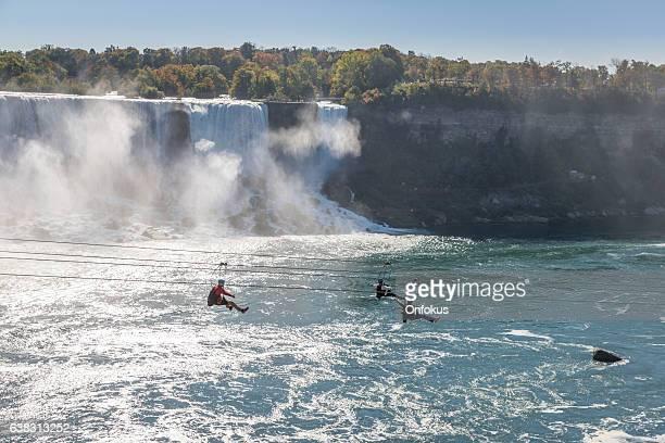 Three People Taking Zipline Ride, Niagara Falls, Ontario, Canada