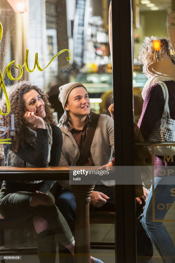 Three people talking in coffee shop : Foto stock