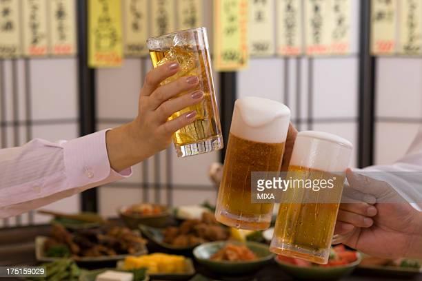 Three People Toasting with Beer and Chu-Hi at Izakaya